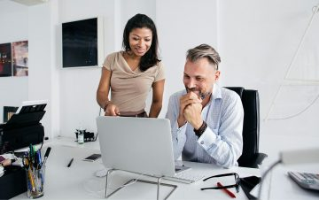 man and lady using a laptop