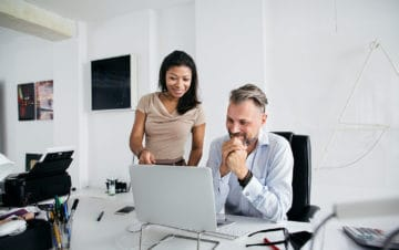 two servium business people working together